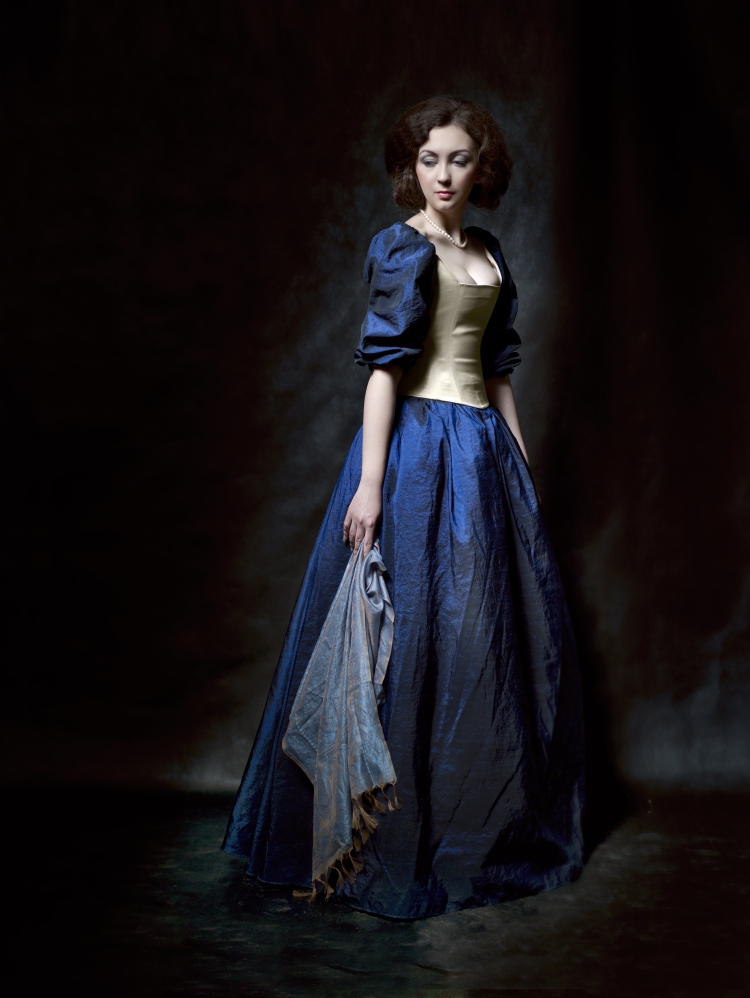 Beautiful girl wearing a medieval dress. Studio works inspired by Caravaggio. Cris. XVII